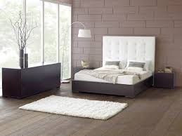 alluring home bedroom design ideas with black wooden bedframe using exciting white upholster high headboard and alluring home bedroom design ideas black