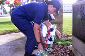 u s department of defense photo essay coast guard recruit elizabeth carson lays a wreath at the foot of the douglas munro statue