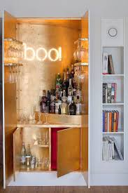 island design ideas designlens extended: gold leaf sheets and illuminated sign for the wardrobe home bar decoist