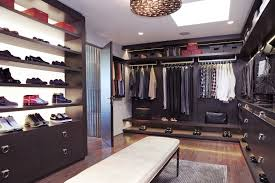 large walk in closet with black solid wood shoe storage rack f having drawers underneath built best closet lighting