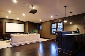 this basement uses recessed lights and two hanging pendant lights basement lighting design
