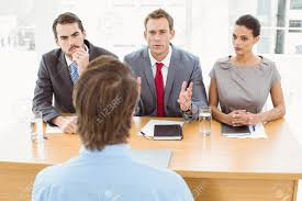 group of business people interviewing man in the office stock group of business people interviewing man in the office stock photo 32789334