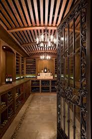 nadeau furniture traditional wine cellar designs denver barrel vault ceiling built in shelving iron gate wine organization wine storage wood slats barrel wine cellar designs