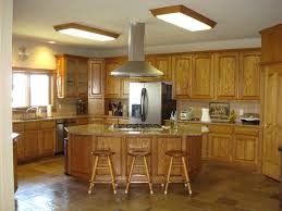 kitchen cabinets home office transitional:  kitchen kitchen color ideas with oak cabinets fruit bowls baskets bakeware tableware pot inserts steamers