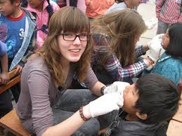 short term volunteering abroad projects abroad zoom a female volunteer provides a check up in