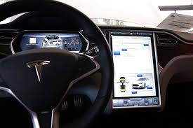 Tesla's plan to leave <b>auto</b> industry behind on <b>in-car entertainment</b>