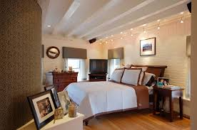 wire track lighting in bedroom contemporary with blue and brown beamed ceiling blue track lighting