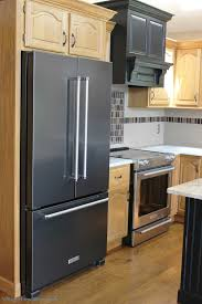 black appliance matte seamless kitchen: black and true stainless steel in a prophetstown il kitchen villagehomestorescom