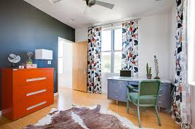 chalkboard wall in the home office with a bold orange cabinet from kailey j chalkboard paint office