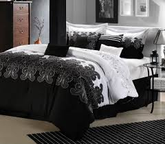 alluring black and white bedroom with fluffy bed and lovely bedding beside classic oak dresser black and white bedroom furniture