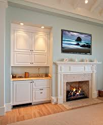 credit to met interiors chic mini kegerator in family room traditional with kegerator next to recessed tv alongside wet bar chic mini bar design