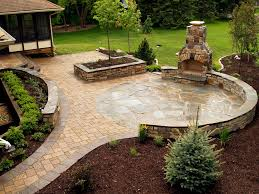 outdoor fireplace paver patio:  stone fireplace and ny bluestone flagstone amp paver patio with stone seating wall by signature patio