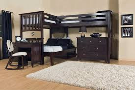 triple loft bunk bed with black hardwood beds frame complete with drawers and wooden desk with chair bunk beds desk drawers bunk