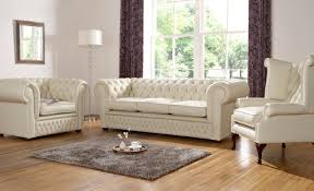 white fabric chesterfield sofa with framed mirror drum floor lamp grey hairy rug on wooden chesterfield sofa leather 3