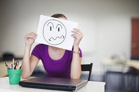 what employers do about employees surfing the web at work negative employee holds face frown picture over her face