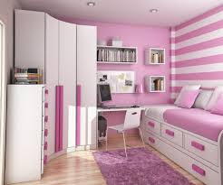 bedroom for girls:  modern girls bedroom with white cabinets and striped backdrop