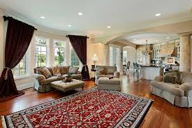 living room in luxury home with two columns casual living room
