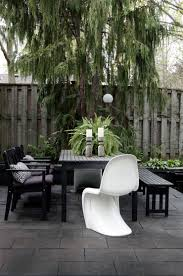 outdoor furniture restoration hardware. my big dining table from ikea is great i have chairs and a bench around it with white plastic panton s on either end outdoor furniture restoration hardware