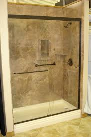 ideas shower systems pinterest: mocha travertine with oil rubbed bronze shower door oasis shower pan recessed shampoo niche