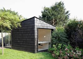 backyard home office. every inch of this tiny backyard studio serves a purpose as office sleeping quarters home