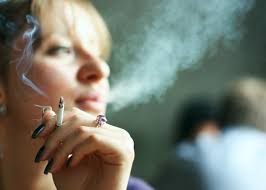 secondhand smoke isn t as bad as we thought a young w smoking cigarette inside
